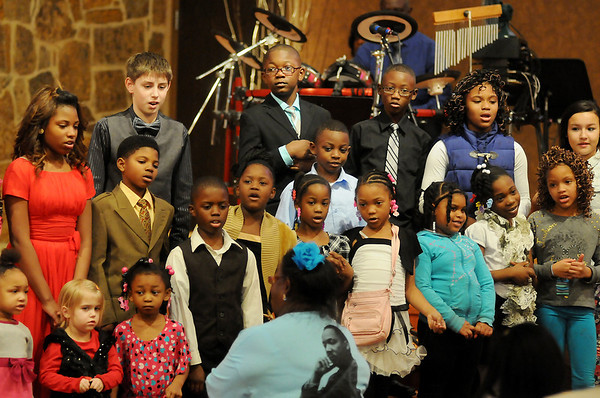 "The Children's Choir sings ""Jesus Loves the Little Children"" during the 26th annual Dr. Martin Luther King, Jr. Holiday Celebration at the Central Assembly of God Family Life Center Sunday, Jan. 19, 2014. (Staff Photo by BONNIE VCULEK)"