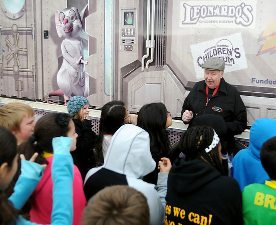 John Wilcox, an Oklahoma Museum Network educator, welcomes Ms. Monthei's fifth-grade students to the Science Matters bus at Coolidge Elementary School Tuesday, Jan. 14, 2014. Children in grades 3-5 will participate in the 2-day events. (Staff Photo by BONNIE VCULEK)