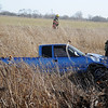 Enid firefighters search the ditch and nearby field for the driver of a truck involved in a rollover accident on S. Leona Mitchell Sunday, Jan. 19, 2014. Life EMS transported the driver to a local hospital. The Garfield County Sheriff Department, Oklahoma Highway Patrol, Enid Fire Department; Waukomis Fire & Rescue and Life EMS responded to the scene after a 911 call from Justin Lamunyon, an Enid attorney who lives near the accident location. (Staff Photo by BONNIE VCULEK)