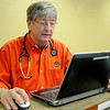 Richard Rivers, MD, with St. Mary's Physicians Associates, reviews his notes following his patient's examinations and places prescription orders Friday, Jan. 03, 2014. Rivers and Barbara Whinery, MD, have had several area residents with viral and bacterial infections, but have not had any influenza cases this winter. (Staff Photo by BONNIE VCULEK)
