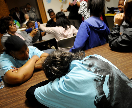An image of Dr. Martin Luther King, Jr. appears on the back of an MLK Holiday Commission t-shirt as marchers gather in the fellowship hall at Grayson Missionary Baptist Church, 334 E. Garriott, prior to the commemorative march Saturday, Jan. 18, 2014. (Staff Photo by BONNIE VCULEK)