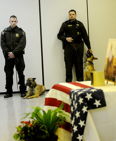 Garfield County Sheriff Deputies and their K-9 partners honor the memory of K-9 Rex during a memorial service at 116 W. Oxford Friday, Jan. 03, 2014. Enid Police Officer Ryan Fuxa and K-9 Rex served together from April 2002 until Rex's retirement in October 2010. K-9 Rex lived with Officer Fuxa and his family until his death Dec. 14, 2013. (Staff Photo by BONNIE VCULEK)