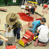 Jerry Sims, the Happy Toy Maker, kneels near the children who play with his indestructible toys during the 18th annual KNID Agrifest at the Chisholm Trail Expo Center Saturday, Jan. 11, 2014. (Staff Photo by BONNIE VCULEK)
