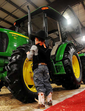 "Gabe ""Pistol"" Sebranek checks out a new John Deere 5065 E Tractor from P & K Equipment during the 18th annual KNID Agrifest at the Chisholm Trail Expo Center Friday, Jan. 10, 2014. (Staff Photo by BONNIE VCULEK)"