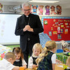 Archbishop Paul Coakley smiles as he watches pre-k students learn mathematical shapes during his classroom visits at St. Joseph Catholic School Wednesday, Jan. 22, 2014. Archbishop Coakley was greeted as he entered each classroom before the 10 a.m. Mass at St. Francis Xavier Catholic Church. (Staff Photo by BONNIE VCULEK)