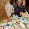 Loretta Fauchier, from the Garfield County Retired Teachers, organizes over-the-counter medical supplies donated by organization members during their luncheon at the NOC-Enid Gantz Center Thursday, Jan. 16, 2014. The supplies will be delivered to the Enid Community Center next Tuesday as part of the groups' community service project. (Staff Photo by BONNIE VCULEK)