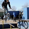 A skateboarder watches (right) as Thomas Martens perfects the over tooth move at the City of Enid skate park Monday, Jan. 20, 2014. (Staff Photo by BONNIE VCULEK)