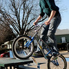 Cody Redding catches air as he performs a 360 off the table at the City of Enid skate park Monday, Jan. 20, 2014. (Staff Photo by BONNIE VCULEK)