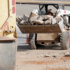 A worker loads old concrete sections into a waiting truck as he prepares the Best Western Inn driveway for new concrete Tuesday, Jan. 14, 2014. According to a Best Western Inn employee, Enid Concrete has been assisting with the new concrete pours around the inn during the exterior remodel. (Staff Photo by BONNIE VCULEK)