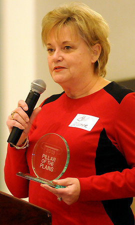 Gail Wynne, recipient of the 2013 Pillar of the Plains award, addresses the audience at Convention Hall Thursday, Jan. 9, 2014. (Staff Photo by BONNIE VCULEK)