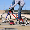Mike Preston does a 180 can over the spine at the City of Enid skate park Monday, Jan. 20, 2014. The bicylist must cross on foot over the frame of his bike while spinning 180 degrees in the air before landing. (Staff Photo by BONNIE VCULEK)