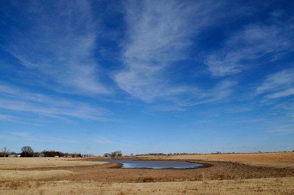 A pond along 54th St. shows the affects of the ongoing drought. The Oklahoma Mesonet site near Breckinridge has recorded 0.04 inches of rain in Jaunary while the Lahoma site has recorded 0.02 inches. (Staff Photo by BILLY HEFTON)