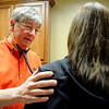 Richard Rivers, MD, with St. Mary's Physicians Associates, examines a patient Friday, Jan. 03, 2014. Rivers and Barbara Whinery, MD, have had several area residents with viral and bacterial infections, but have not treated anyone who has influenza this winter. (Staff Photo by BONNIE VCULEK)