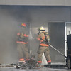 Smoke billows out of a building as firefighters battle a blaze in the 200 block of West Cherokee Friday, Jan. 17, 2014. The Enid Fire Department, Enid Police Department and Life EMS responded to the scene. (Staff Photo by BONNIE VCULEK)