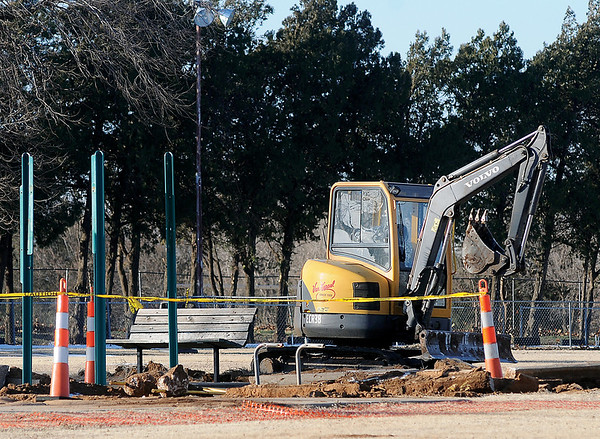 Playground equipment is being removed near the south pavilion Wednesday, Jan. 8, 2014. (Staff Photo by BONNIE VCULEK)