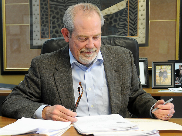 Jon Blankenship, President and CEO of the Greater Enid Chamber of Commerce, refers to his notes during an interview in his office at 210 Kenwood Blvd. Wednesday, Jan. 22, 2014. (Staff Photo by BONNIE VCULEK)