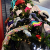 New mittens, hats and scarves adorn a Christmas tree inside the Public Library of Enid and Garfield County Thursday, Jan. 2, 2014. All donations will be distributed to local children. (Staff Photo by BONNIE VCULEK)