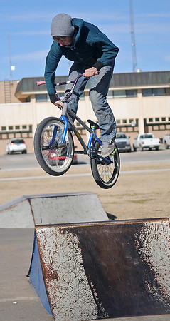 Cody Redding catches air as he performs a 360 tire tap over the spine at the City of Enid skate park Monday, Jan. 20, 2014. (Staff Photo by BONNIE VCULEK)
