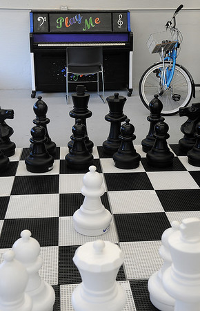 A gigantic chess game and piano, designed by the Waller Middle School art student appears inside the new Main Street Enid office at 217 N. Washington Friday, Jan. 10, 2014. The larger location provides ample space for the staff and business meetings. (Staff Photo by BONNIE VCULEK)