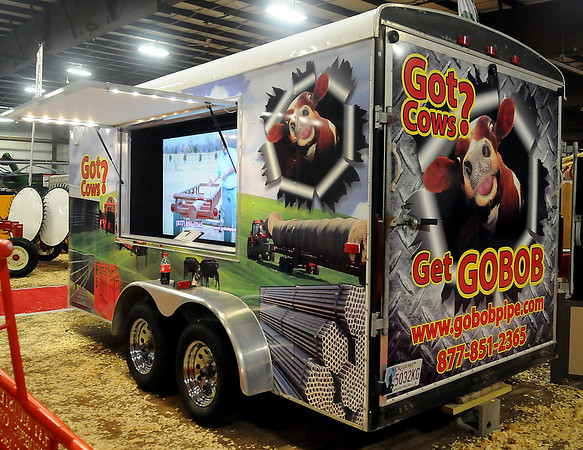 Unique trailer graphics and a large flat screen television advertise GOBOB Pipe products during the 18th annual KNID Agrifest 2014 at the Chisholm Trail Expo Center Friday, Jan. 10, 2014. The show continues today until 5 p.m. (Staff Photo by BONNIE VCULEK)