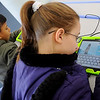 Don Romo and Talynn Burton (from left) check out the games on the new Samsung tablets at the Public Library of Enid and Garfield County Thursday, Jan. 2, 2014. The Library's newest technology is available for use in the children and teen section. (Staff Photo by BONNIE VCULEK)