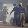 Enid firefighters break the glass in a rear entrance to Paramount Real Estate as they battle a blaze in the 200 block of West Cherokee Friday, Jan. 17, 2013. (Staff Photo by BONNIE VCULEK)