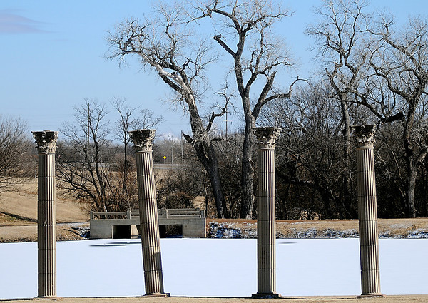 Ancient pillars appear on the west side of the icy, snow covered NOC-Enid Lake Tuesday, January 28, 2014. (Staff Photo by BONNIE VCULEK)