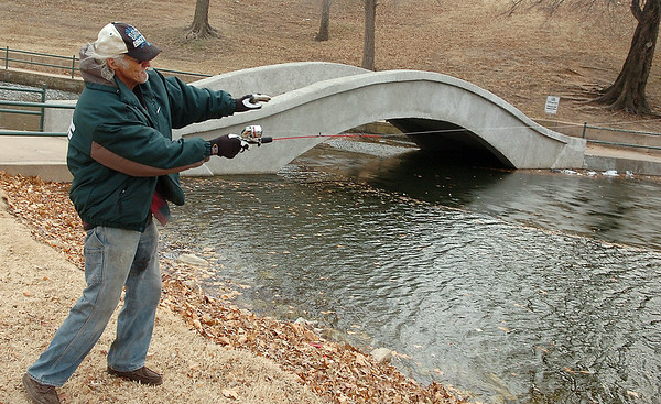 James Noland tries his luck at Government Springs Park Wednesday. Noland said, he didn't expect to catch anything but, enjoys casting a line. (Staff Photo by BILLY HEFTON)