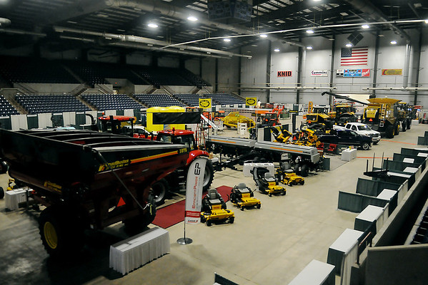 Businesses prepare for the 2014 KNID Agrifest in the Chisholm Trail Coliseum Thursday, Jan. 9, 2014. Hundreds of vendors will fill the Chisholm Trail Expo Center during the two-day show. (Staff Photo by BONNIE VCULEK)