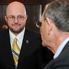 Brent Kisling, executive director for Enid Regional Development Alliance, visits with Enid Mayor Bill Shewey prior to the ERDA quarterly luncheon at Oakwood Country Club Thursday, Jan. 23, 2014. (Staff Photo by BONNIE VCULEK)