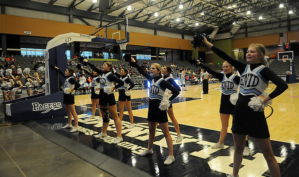 Enid High School cheerleaders lead the Pacer and Plainsmen fans during a school cheer at the Enid Event Center Saturday, Jan. 18, 2014. (Staff Photo by BONNIE VCULEK)