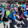 Children from St. Joseph Catholic School gather outside St. Francis Xavier Catholic Church for their balloon release during National Catholic Schools' Week Wednesday, Jan. 29, 2014. The owner of the balloon that travels the farthest and is returned to the school will receive a prize. (Staff Photo by BONNIE VCULEK)