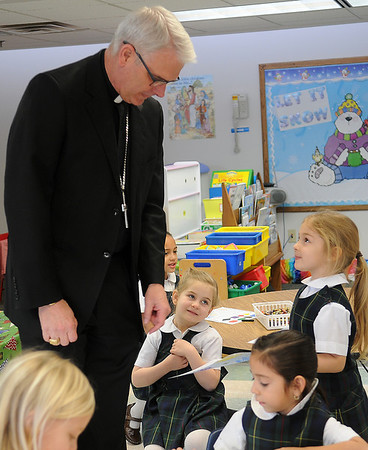 Archbishop Paul Coakley identifies different shapes with pre-k students at St. Joseph Catholic School before the 10 a.m. Mass at St. Francis Xavier Catholic Church Wednesday, Jan. 22, 2014. The Archbishop briefly discussed his recent trip to Bethlehem and answered student questions during an informal visit in each classroom. (Staff Photo by BONNIE VCULEK)