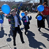 St. Joseph Catholic School first-grade students sprint forward as they celebrate National Catholic Schools' Week with a school-wide balloon release Wednesday, Jan. 29, 2014.  The owner of the balloon that travels the farthest and is returned will receive a prize. (Staff Photo by BONNIE VCULEK)