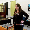 Kelly Tompkins, the director of Main Street Enid, pauses inside their new location at 217 N. Washington. (Staff Photo by BONNIE VCULEK)
