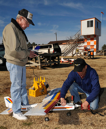 Rich Richardson (left) helps student pilot, Calvin Henneke, start his remote controlled planes for a flying lesson Wednesday at the S.P.A.D.S. R/C Club Flying Field. (Staff Photo by BILLY HEFTON)