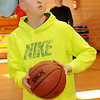 Caleb Meadows, 10, takes some practice shots before he competes in the Knights of Columbus free throw championship at St. Joseph Catholic School gym Saturday, Jan. 11, 2014. Meadows hit 14/20 shots. (Staff Photo by BONNIE VCULEK)