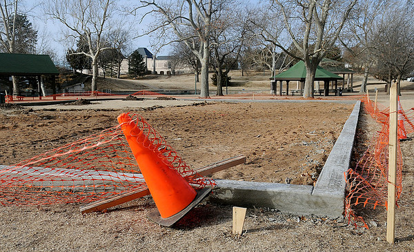 A new concrete stem wall around the expanded playground area at Government Springs Park Wednesday, Jan. 15, 2014. The City of Enid are currently updating the children's play areas at Glenwood, Government Springs and Meadowlake Parks. (Staff Photo by BONNIE VCULEK)