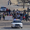 Enid Police officers escort marchers honoring Dr. Martin Luther King, Jr. during a holiday commission commemorative march from Grayson Missionary Baptist Church, 334 E. Garriott, past the Cherokee Strip Regional Heritage Center, along Owen K. Garriott to 7th Street and west on E. Oklahoma as they circle Government Springs Park Saturday, Jan. 19, 2014. The MLK Celebration continues Sunday at the Central Assembly of God Family Life Center at 4 p.m. (Staff Photo by BONNIE VCULEK)