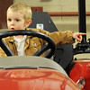 Blaze Bivin, from Aline, points to another tractor as he attends the 18th annual KNID Agrifest at the Chisholm Trail Expo Center Friday, Jan. 10, 2014. The show continues today from 9 a.m.-5 p.m. (Staff Photo by BONNIE VCULEK)