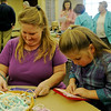 Kimberly Crandall and her daughter, Abigail, use looms as they create pot holders during the Cherokee Strip Regional Heritage Center family Saturday activities Jan. 18, 2014. (Staff Photo by BONNIE VCULEK)