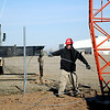 An employee with Gotcher Towers in Broken Arrow positions a guy wire for the new 300 foot emergency tower outside the Enid/Garfield County Emergency Management office near the Garfield County Fairgrounds Tuesday, Jan. 13, 2015. (Staff Photo by BONNIE VCULEK)