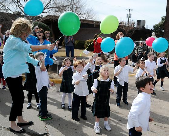 Balloons fly as pre-kindergarten students from St. Joseph Catholic School celebrate National Catholic School Week at St. Francis Xavier Catholic School Wednesday, Jan. 28, 2015. (Staff Photo by BONNIE VCULEK)
