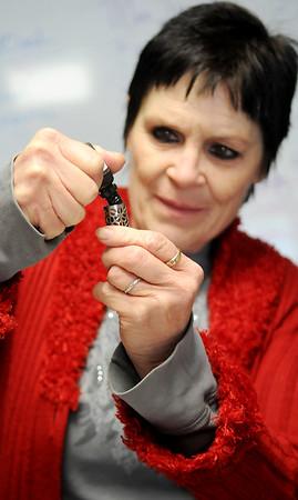 Deana Cash refills her e-cigarette at etown Vapor Thursday, Jan. 15, 2015. (Staff Photo by BONNIE VCULEK)