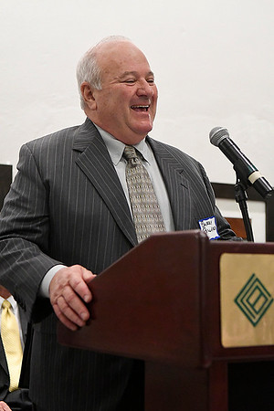 Dr. Barry Pollard laughs as he adresses the audience after being named 2016 Pillar of the Plains during a reception Thursday January 12, 2017 at the Central National Bank Center. (Billy Hefton / Enid News & Eagle)