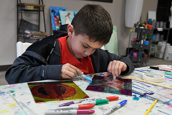 Isaiah Purcell works on a project during after school lessons at Creatice Arts Enid Tuesday January 17, 2017. (Billy Hefton / Enid News & Eagle)