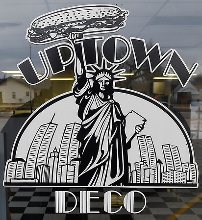 Logo on the door of Uptown Deco. The merger of Deco Pizzeria and Uptown Subs is scheduled to open today at 1909 W. Garriott. (Billy Hefton / Enid News & Eagle)