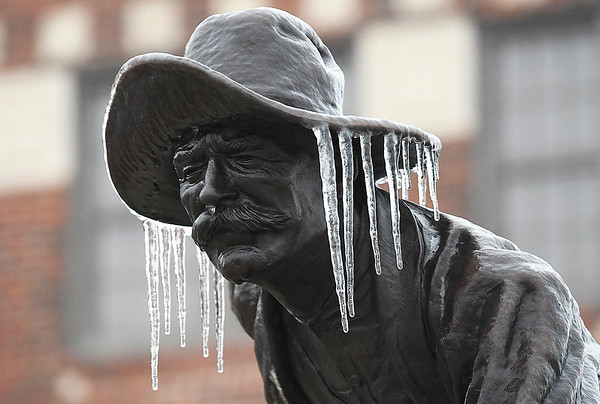"""Icicles hang fron the Harold Holden sculpture """"Boomer"""" Sunday January 15, 2017. (Billy Hefton / Enid News & Eagle)"""