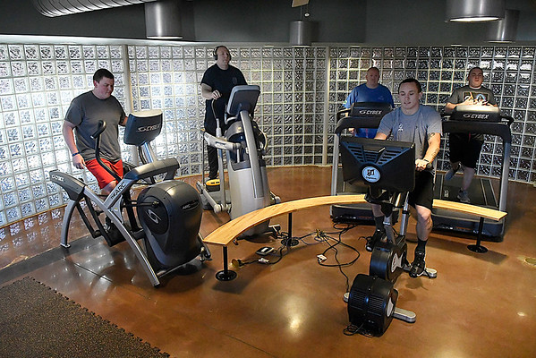 Enid police officers work out the gym at the Enid Police department. (Billy Hefton / Enid News & Eagle)