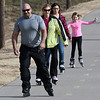 A family takes advantage of the warm weather Monday January 2, 2017 to roller blade on the Enid Trail system. (Billy Hefton / Enid News & Eagle)